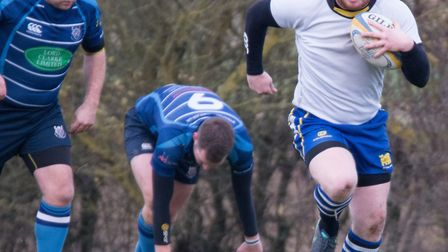 Paul Ashbridge leaves a couple of opponents trailing during St Ives' demolition of Rugby St Andrews.