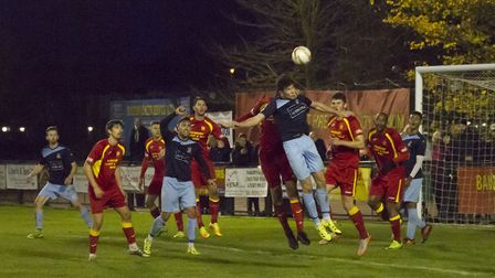 Taylor Parr climbs highest during St Neots Town's deadlock at Banbury. Picture: CLAIRE HOWES