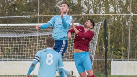 Godmanchester Rovers defender Arran Mackay in aerial action. Picture: J BIGGS PHOTOGRAPHY