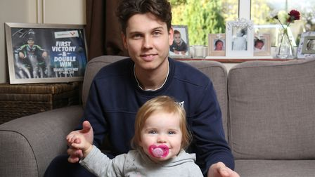 Luke Mossey at home with his 13 month old daughter. Picture: Tyler Bilton