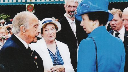 Pam and John Clifford joined other war veterans at Buckingham Palace. The couple are pictured meetin