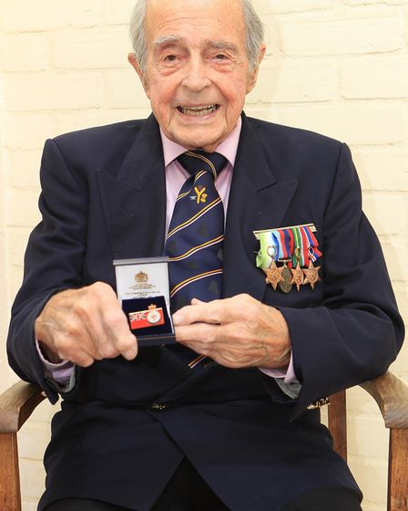 John Clifford with the veterans medal he received at Mansion House. Photo: DANNY LOO.