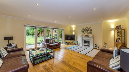 The spacious sitting room opens out onto the rear garden