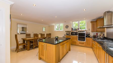 The kitchen/breakfast room has a large central island unit