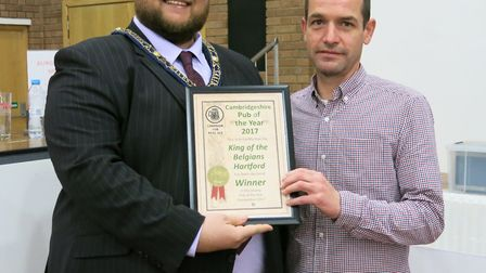 TOP PUB: Mayor of St Ives Cllr Philip Pope presents the Cambridgeshire Pub of the Year award to Matt