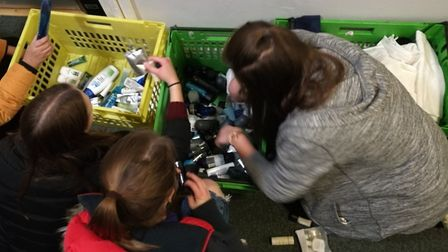 Explorer Scouts helping sort toiletries for the rucksacks. Photo: St Albans Explorer Scouts