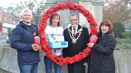 Unveiling the giant poppy wreath at the St Peter's Street war memorial. From left to right: Reverend