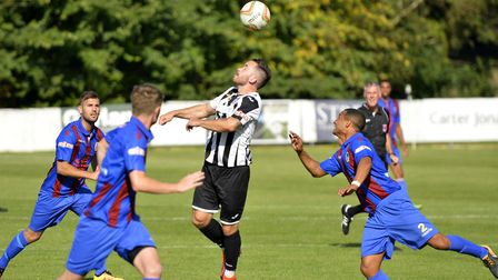 James Hall struck twice for St Ives Town.