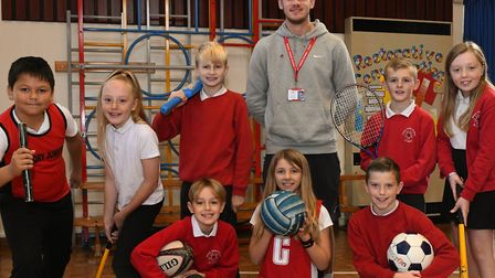 Liam Smith with pupils Patrick, Grace, JJ, Ollie, Bobbie, Luca, Keira and Alfie.