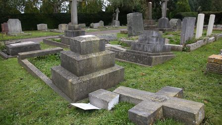 Damaged gravestones in Westfield Road Cemetery. Picture: Danny Loo