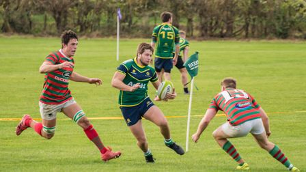 Try-scorer Barnie West on the run for Huntingdon in their success against Market Rasen & Louth. Pict