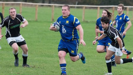 Tommy Newman on the charge as St Ives triumphed in the Midlands Senior Vase. Picture: PAUL COX