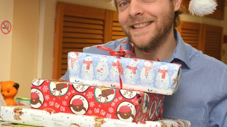 Hunts Post Content Editor Daniel Mansfield, with some of the presents from readers for Holly Ward,