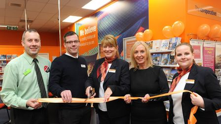 Colleagues from Central England Co-operative St Ives Travel Store cut the ribbon as part of an offic