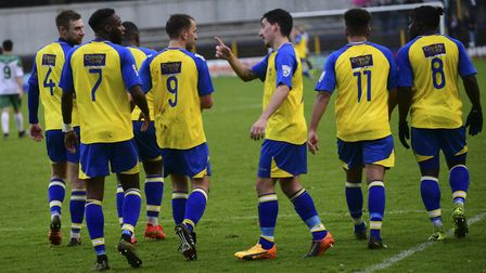 Sam Merson is congratulated by the St Albans City players. Picture: BOB WALKLEY