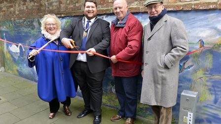 Artist Denny Goudin, Councillor Phil Pope, Ron Westrip and Dr George Smerdon with her mural in St Iv