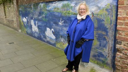 Artist Denny Goudin with her mural in St Ives. Picture: DUNCAN LAMONT.