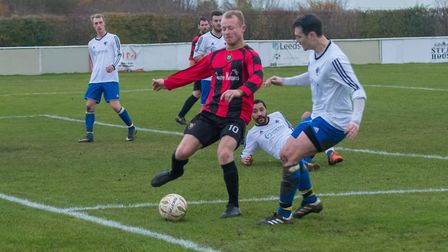 Huntingdon Town striker Chae Simons was one of several players denied by good saves in their defeat