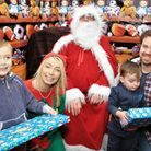 The Seber family receiving presents from Santa at the Melbourn Hub Grotto. Hugo and brother Willem w