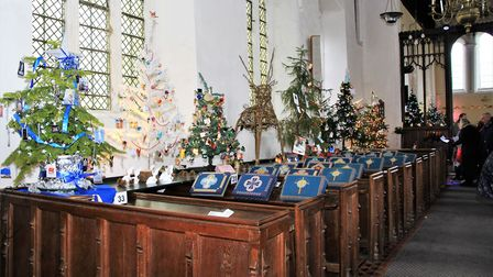 Decorated Christmas pews at Meldreth church. Picture: Clive Porter