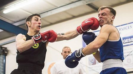 Jake Brading (left) throws a punch during his New Saints ABC debut outing. Picture: LUCY NICOLE PHOT