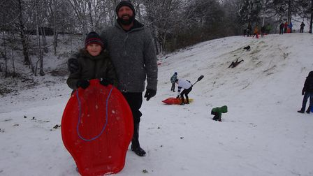 SNOW: Ben and Rhys Howells test the snow at Castle Hill in Huntingdon