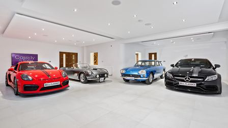 The basement garage can easily accommodate four snazzy motors