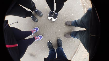 Media Rise Up group feet.