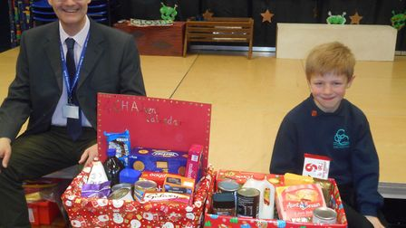 Johan Todd handed the hampers over to David Paccin from the St Neots Foodbank.