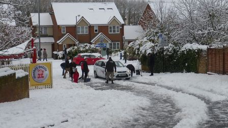 Residents helping clear Orient Close. Photo: Peter Wares.