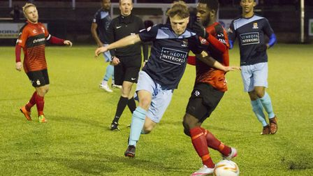 Stefan Broccoli in the thick of the action during his full St Neots Town debut at Redditch last Satu