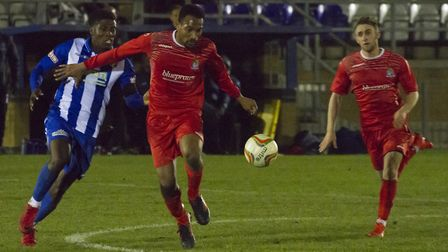 St Neots Town match-winner Nabil Shariff holds off a Bishop's Stortford defender. Picture: CLAIRE HO