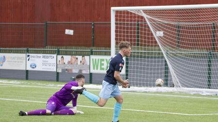 Stefan Broccoli hits his first St Neots Town to put them ahead at Redditch yesterday. Picture: CLAIR