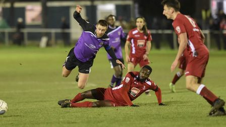 St Albans City's David Noble goes airborne after a Whitehawk tackle. Picture: BOB WALKLEY