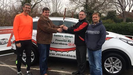 Mantles operation directior John Roberts, second right, handing over keys to 'Santa's sleigh' to Rou