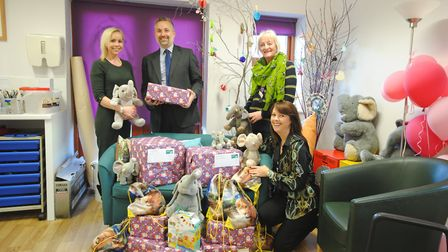 Aitchison Raffety staff delivering gifts to the Hospice of St Francis