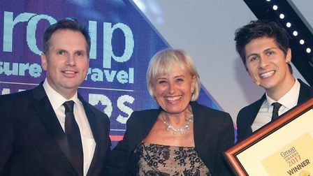 Alastair Campbell from Travelsphere (left) and special guest Ben Hanlin (right) presenting the award