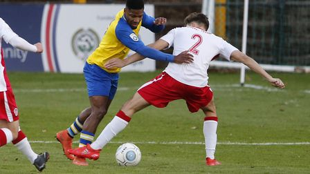 Shaun Lucien is brought down in the penalty area. Picture: LEIGH PAGE
