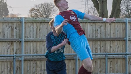 Eaton Socon goalscorer Rhys Thorpe gets off the ground as they beat Brampton last Saturday. Picture: