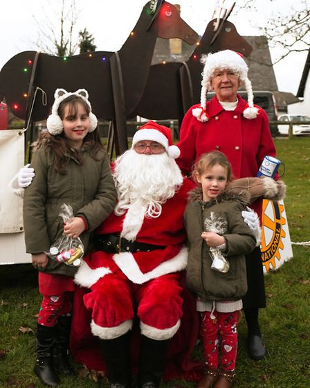 Father Christmas and Mrs Claus with Chloe, left, and Melaine, right. Picture: ARCHANT