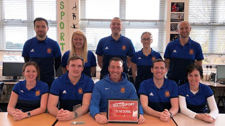 The St Ivo School PE department show off their award. They are, back row, left to right, Ben Daly, L