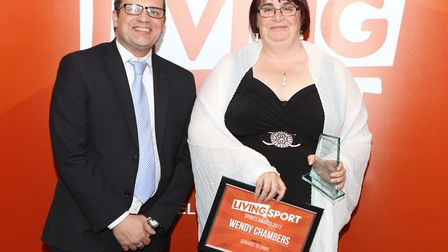 Wendy Chambers receives the Services to Sport prize from Warren Smythe, chief executive of Abbeycrof