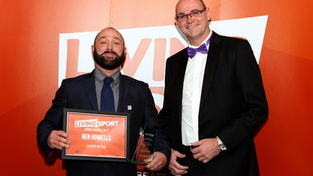 Ben Howells (left) receives his coach of the year accolade from Martin Croucher of sponsors BGL at t