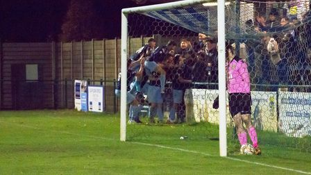 St Neots Town players celebrate their last-gasp success against Basingstoke. Picture: CLAIRE HOWES