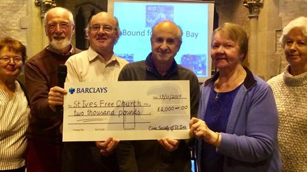 INSPIRING: David Stewart, second left, chairman of St Ives Civic Society, presents the cheque to mem