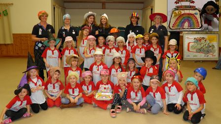 The entire 1st Melbourn Rainbows unit. Inset, birthday cake and badges the girls collect. Picture: R