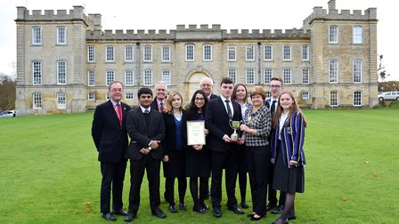 Moira Penney, president of the Rotary Club of St Ives, with the winning Kimbolton School quiz team.