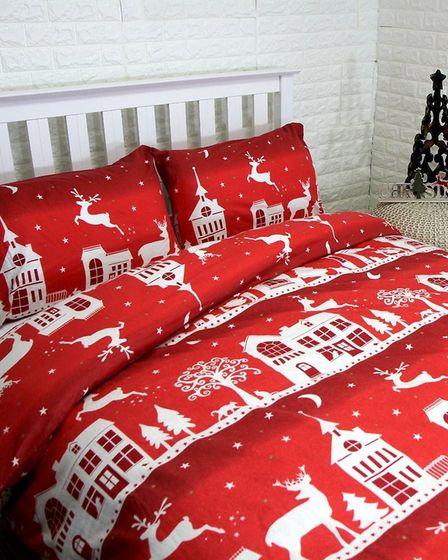 Winter warmer: red reindeer print duvet cover set, 100% cotton; £19 from www.pasx.co.uk