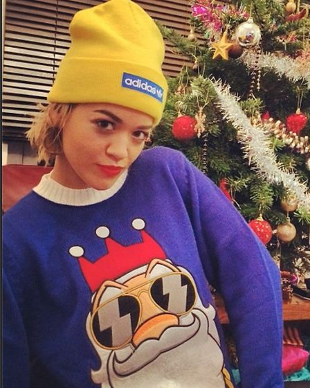 Christmas funk: Pop star Rita Ora gets into the spirit with a jumper from www.FunkyChristmasJumpers.