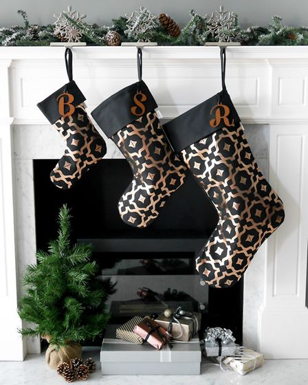 Santa wont miss these: metallic stockings from Penelope Hope in Moroccan-inspired Tahaa print. Lined